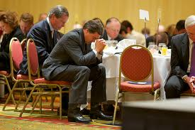 Governor Perry praying